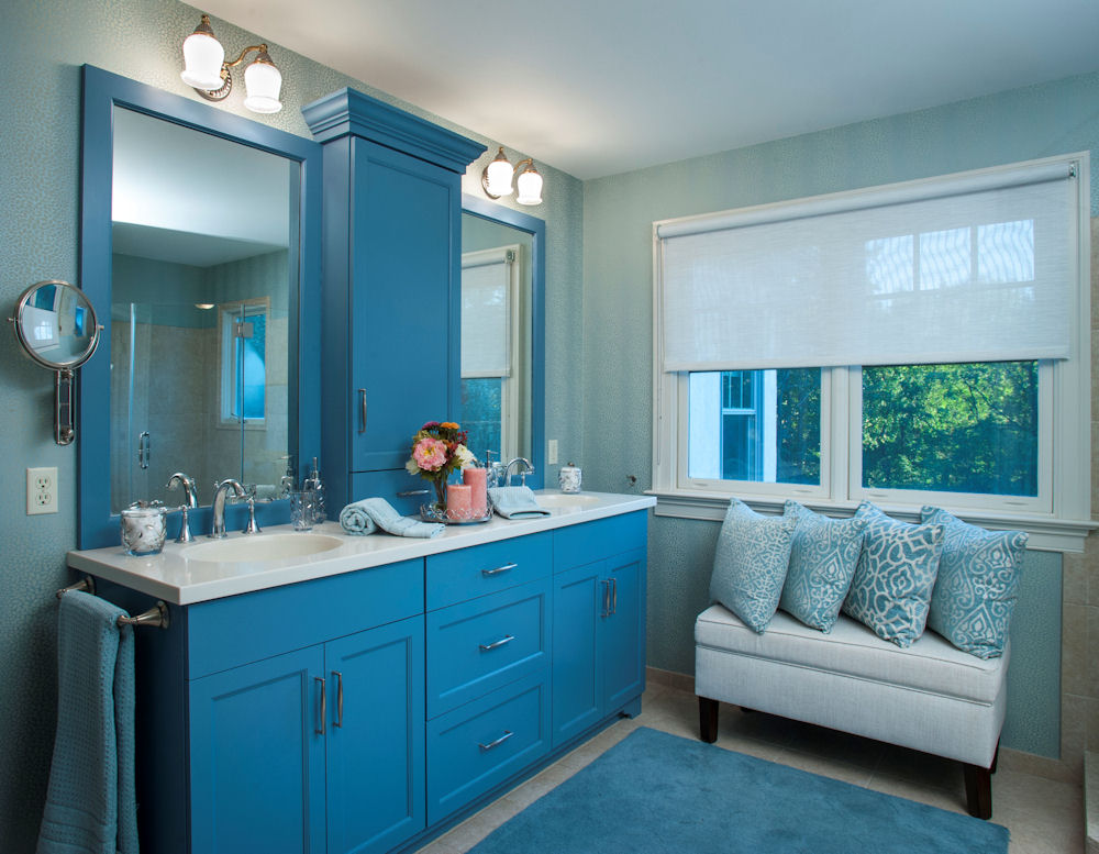 For continuity, the blue palette in the master bath evokes the same calm and serenity as the master bedroom.