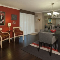 Stimulate your appetite and the conversation in this eclectic red and taupe Dining Room.